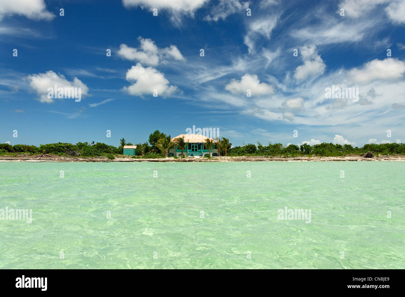 Bahamas, Grand Bahama Island, MacLean Town, Creole house on an island surrounded by clear waters - Stock Image