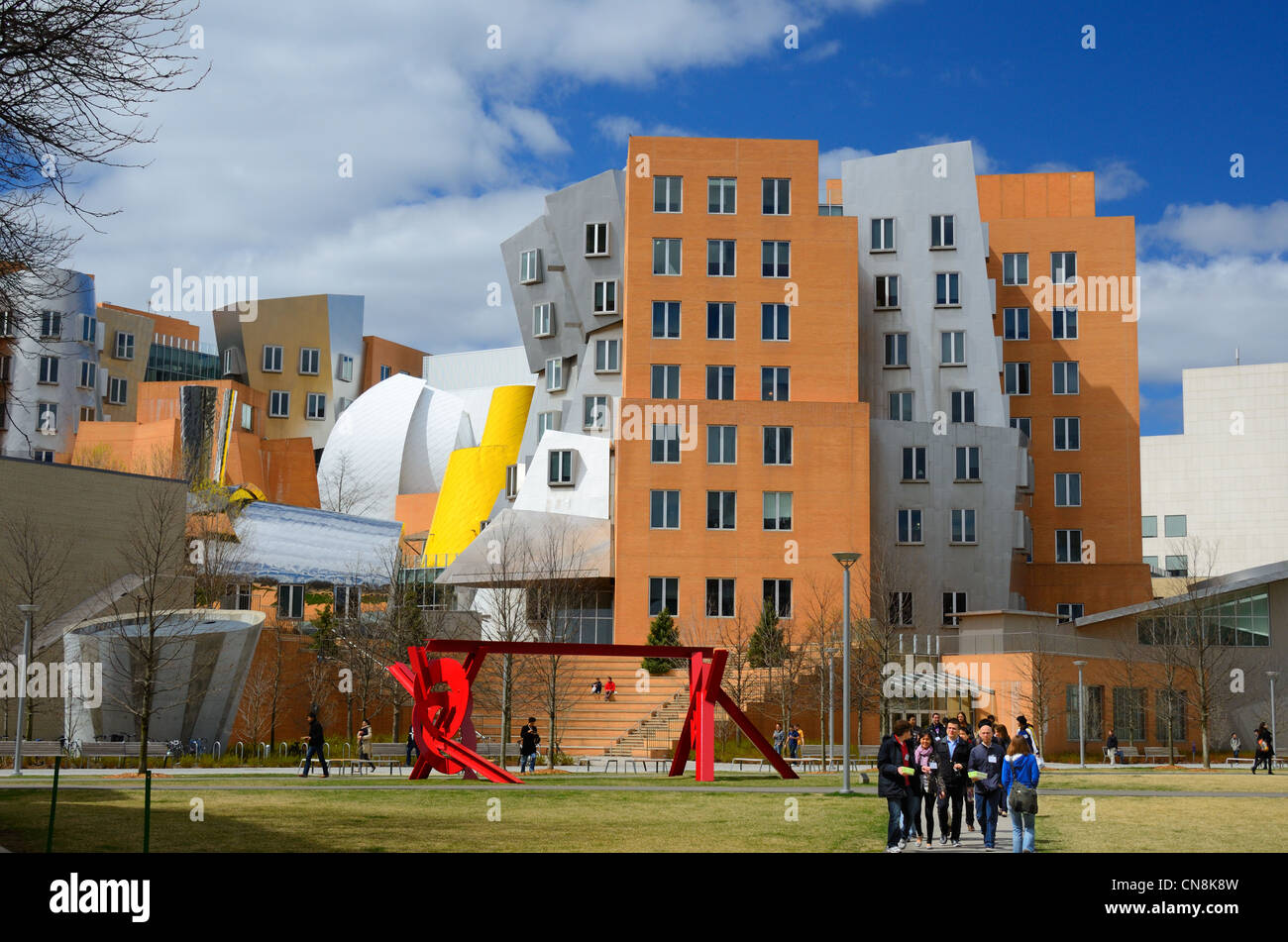 Students below the Stata Center on the campus of the Massachusetts Institute of Technology in Cambridge, Massachusetts. - Stock Image