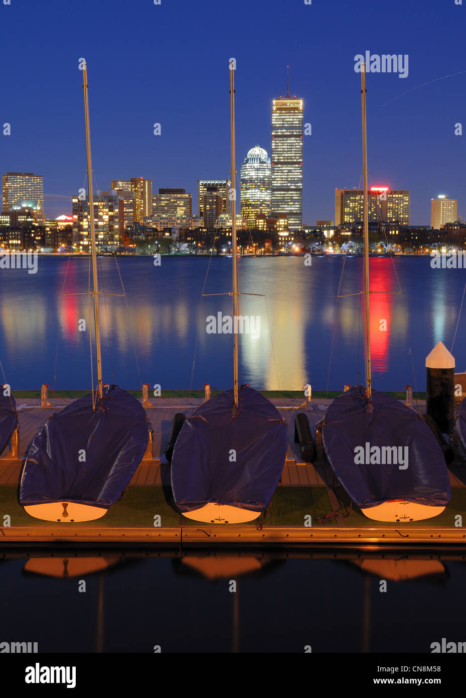 Docked boats against the cityscape of Back Bay Boston, Massachusetts, USA from across the Charles River. Stock Photo