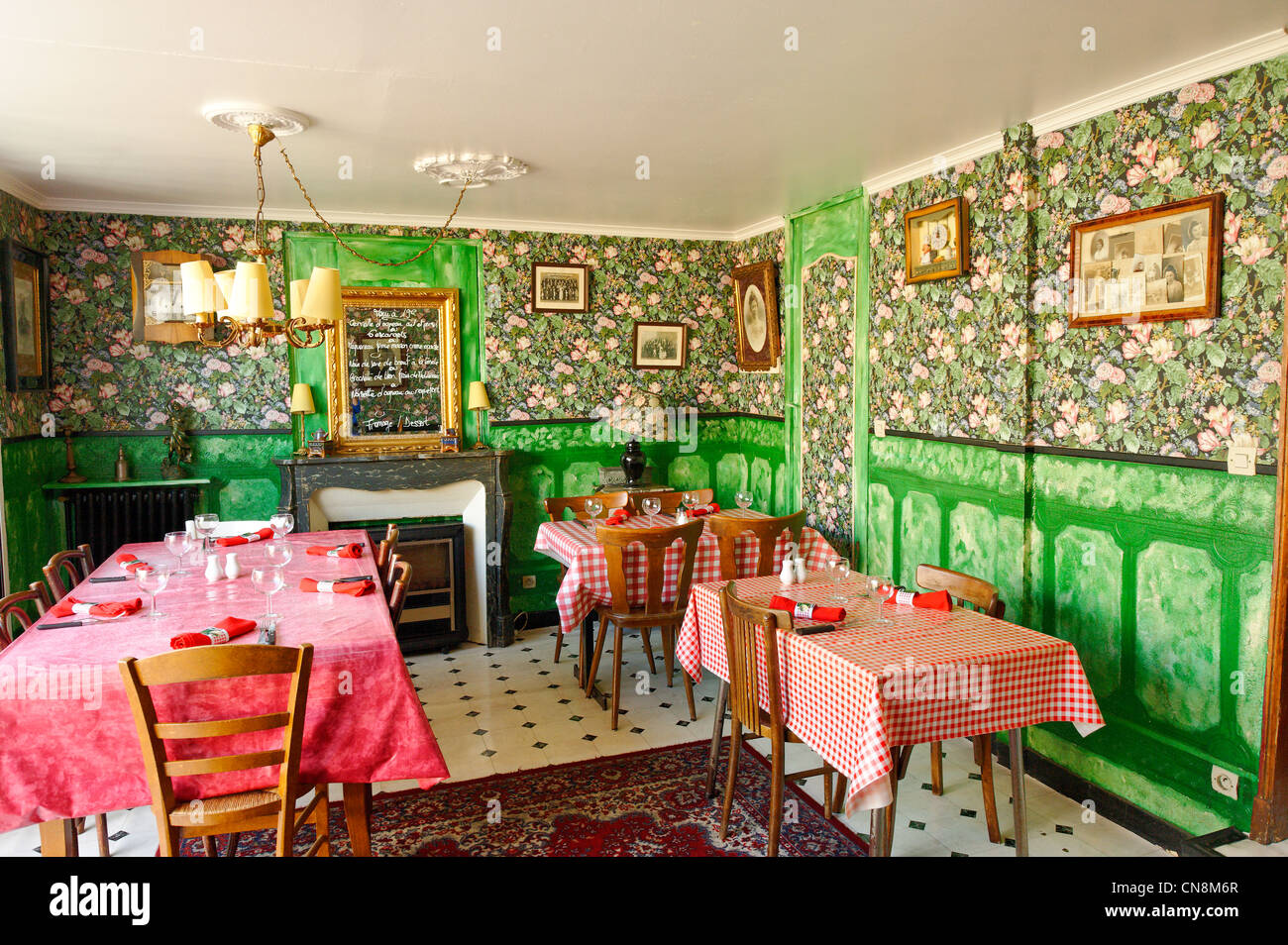 France, Meuse, Verdun, Chez Mamie, dining room with Vichy water tables and Rococo wallpaper - Stock Image