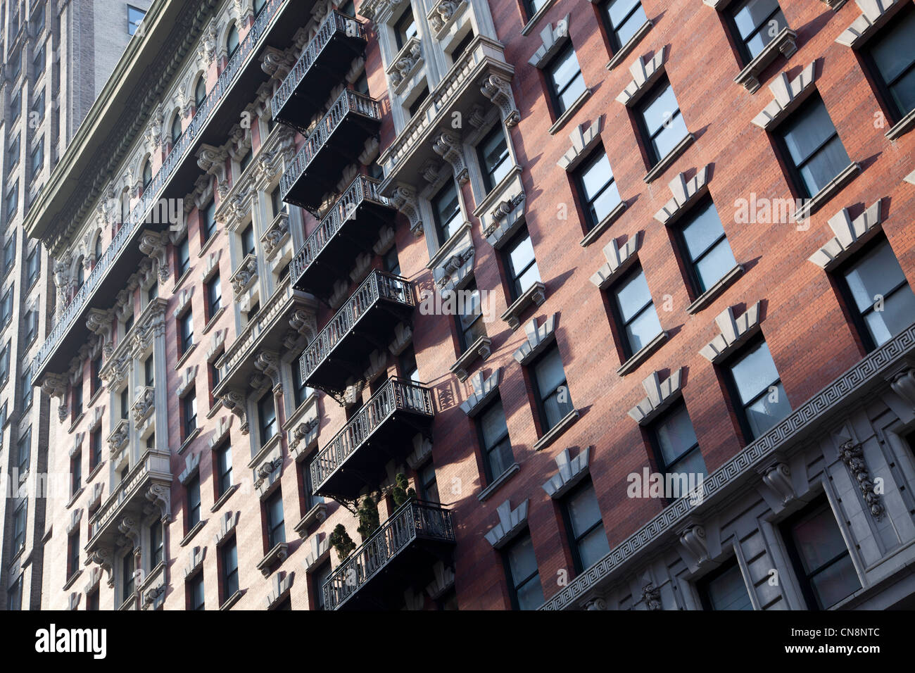 Ornate balconies on the side of a building in Manhattan, New York City - Stock Image