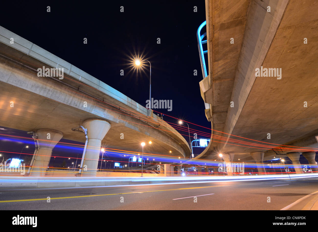Highway and roads with light trails at night - Stock Image
