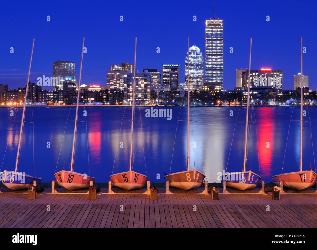 Docked boats against the cityscape of Back Bay Boston, Massachusetts, USA from across the Charles River. - Stock Image