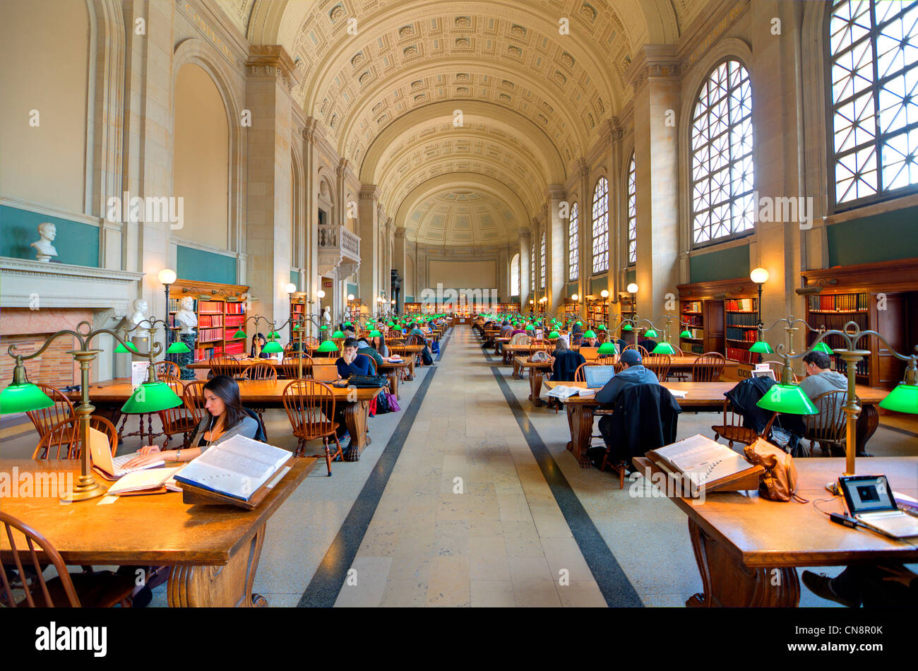 Visitors peruse materials at Bates Hall in Boston Public Library, the oldest publicly funded library in the USA. - Stock Image