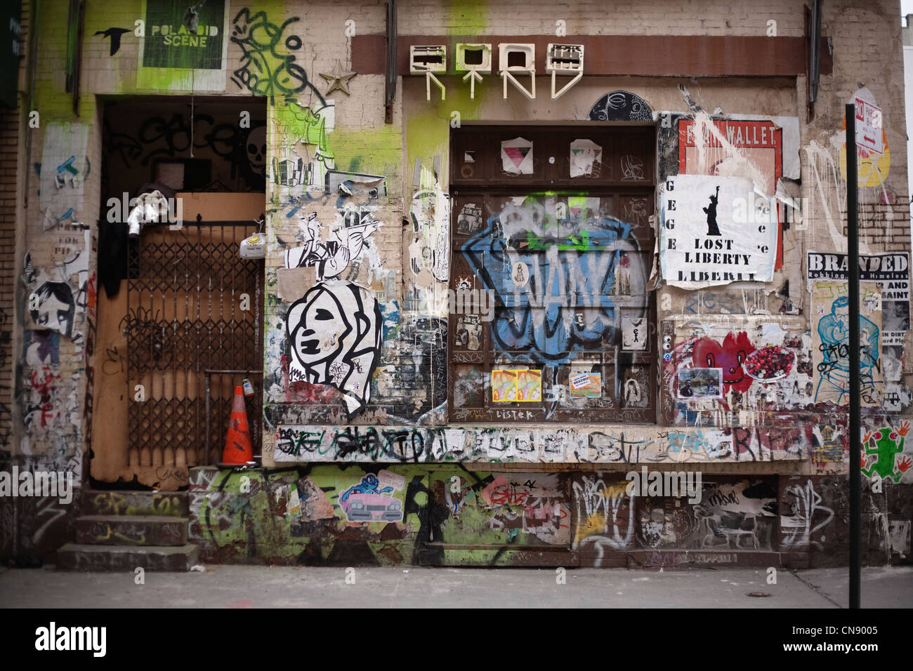 Vacant property covered in graffiti, SoHo district, Manhattan, New York City, New York, USA - Stock Image
