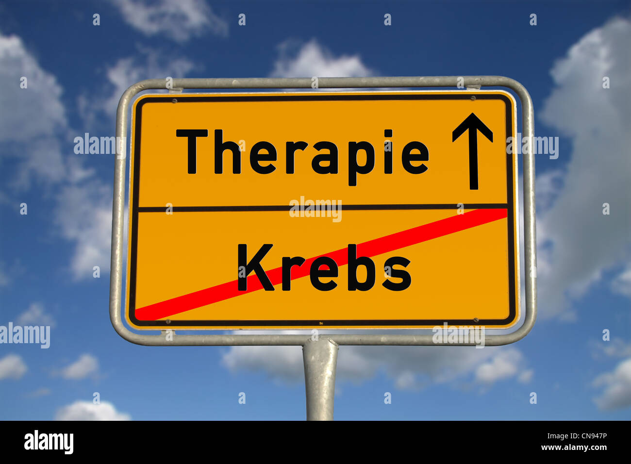 German road sign cancer and therapy with blue sky and white clouds - Stock Image