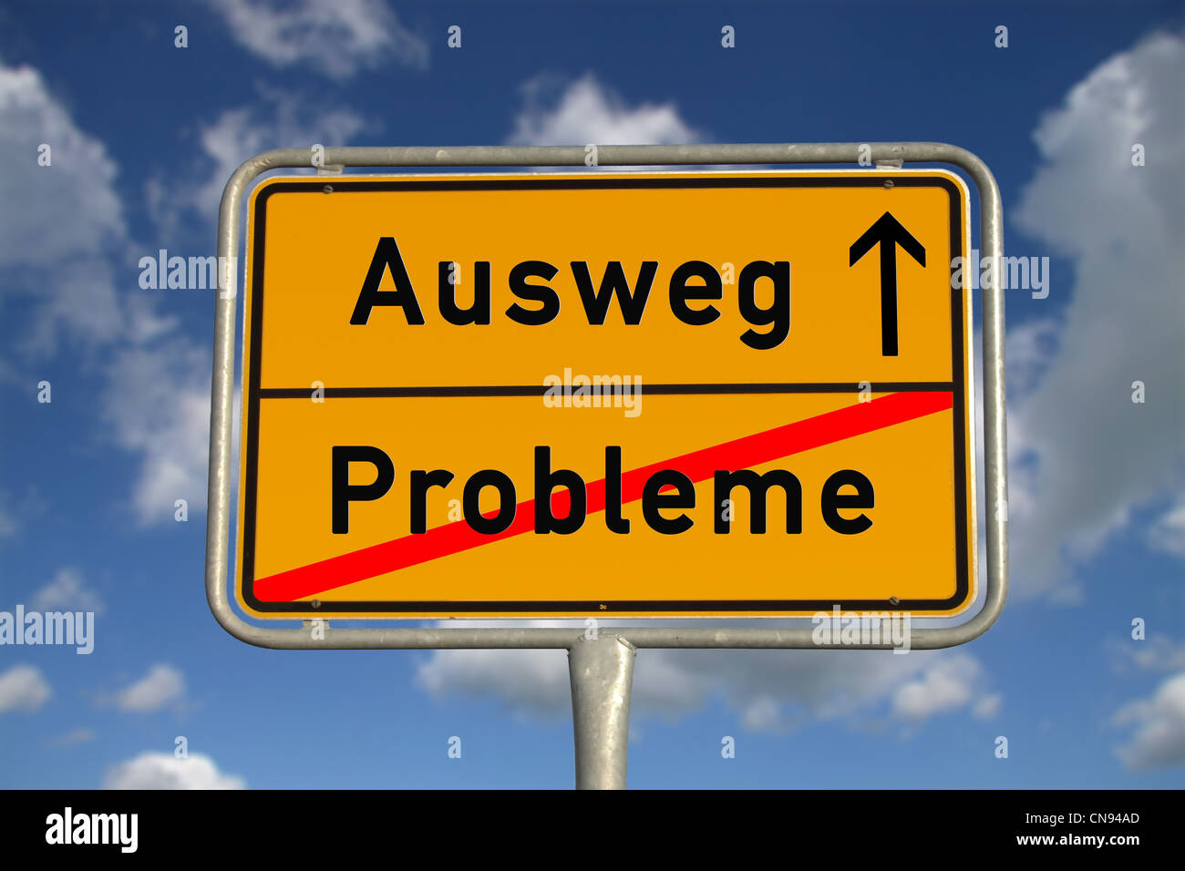 German road sign problems and way out with blue sky and white clouds - Stock Image