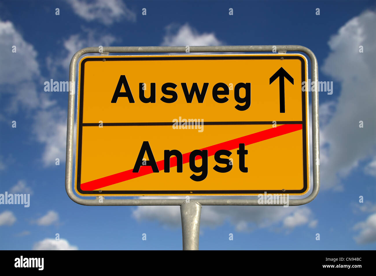 German road sign fear and way out with blue sky and white clouds - Stock Image