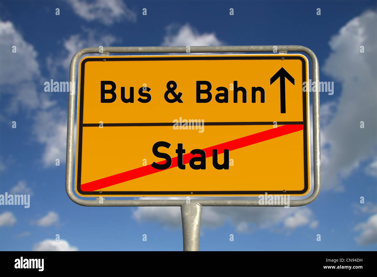 German road sign traffic jam and public transport with blue sky and white clouds - Stock Image