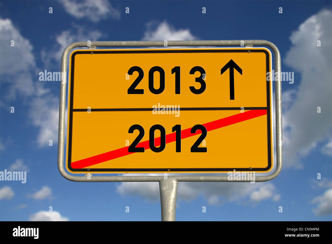 German road sign traffic 2012 and 2013 with blue sky and white clouds - Stock Image
