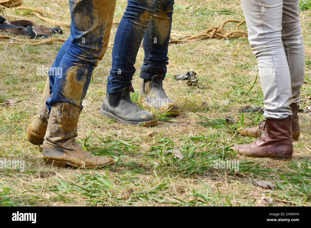 Cowgirls wearing muddy boots in a rodeo show stock photo for Dirty foot mud ranch