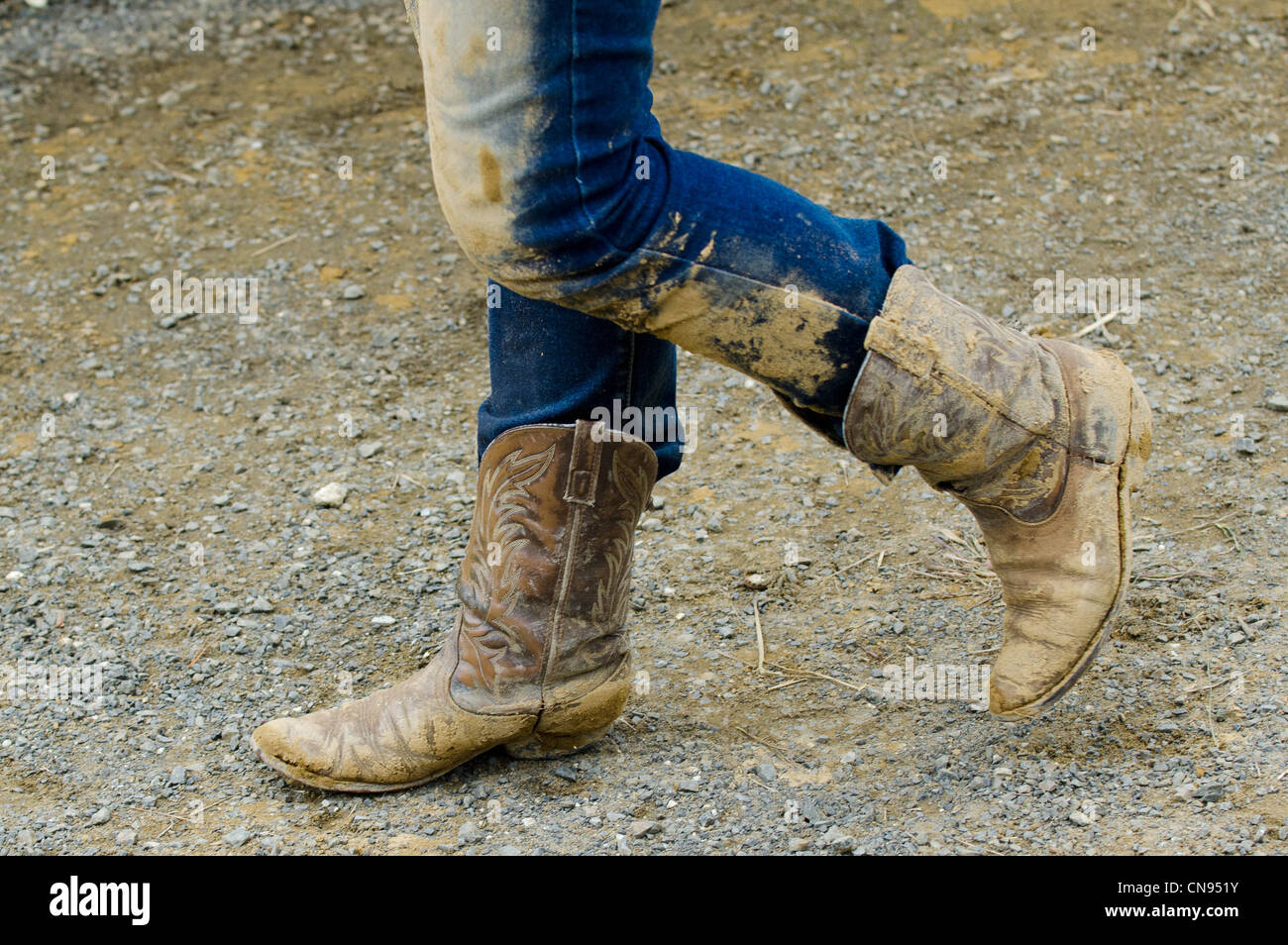 Cowgirl wearing muddy boots in a rodeo show stock photo for Dirty foot mud ranch