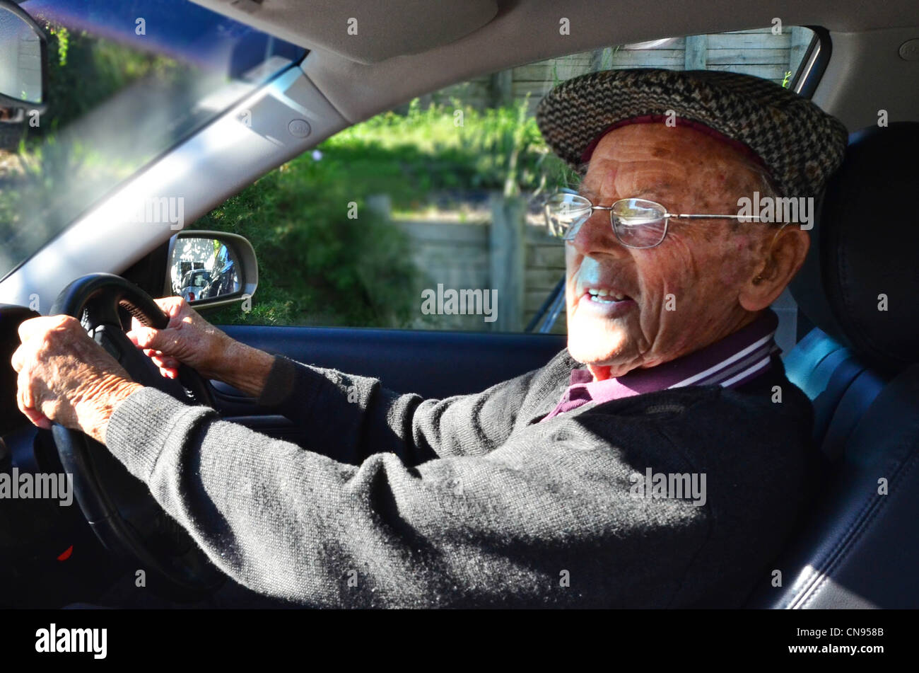 A very old man with a valid driving license drives a car Stock Photo ...