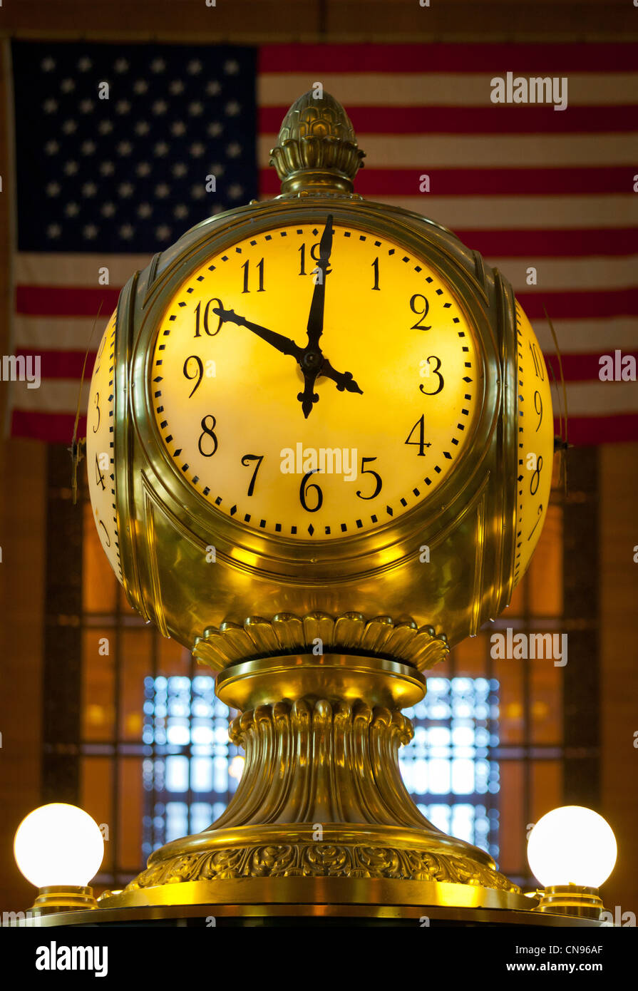 Clock and flag in the Main Concourse of New York City's Grand Central Terminal - Stock Image