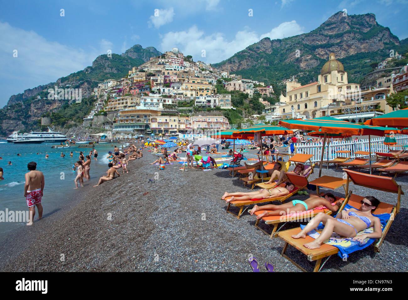 people at the beach of the village positano amalfi coast unesco