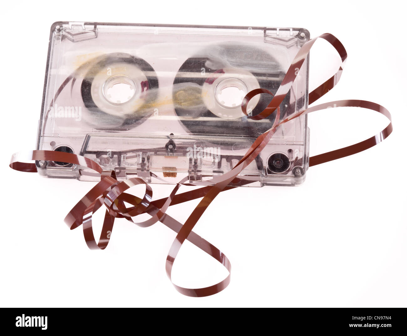 Old broken cassette isolated on white - Stock Image