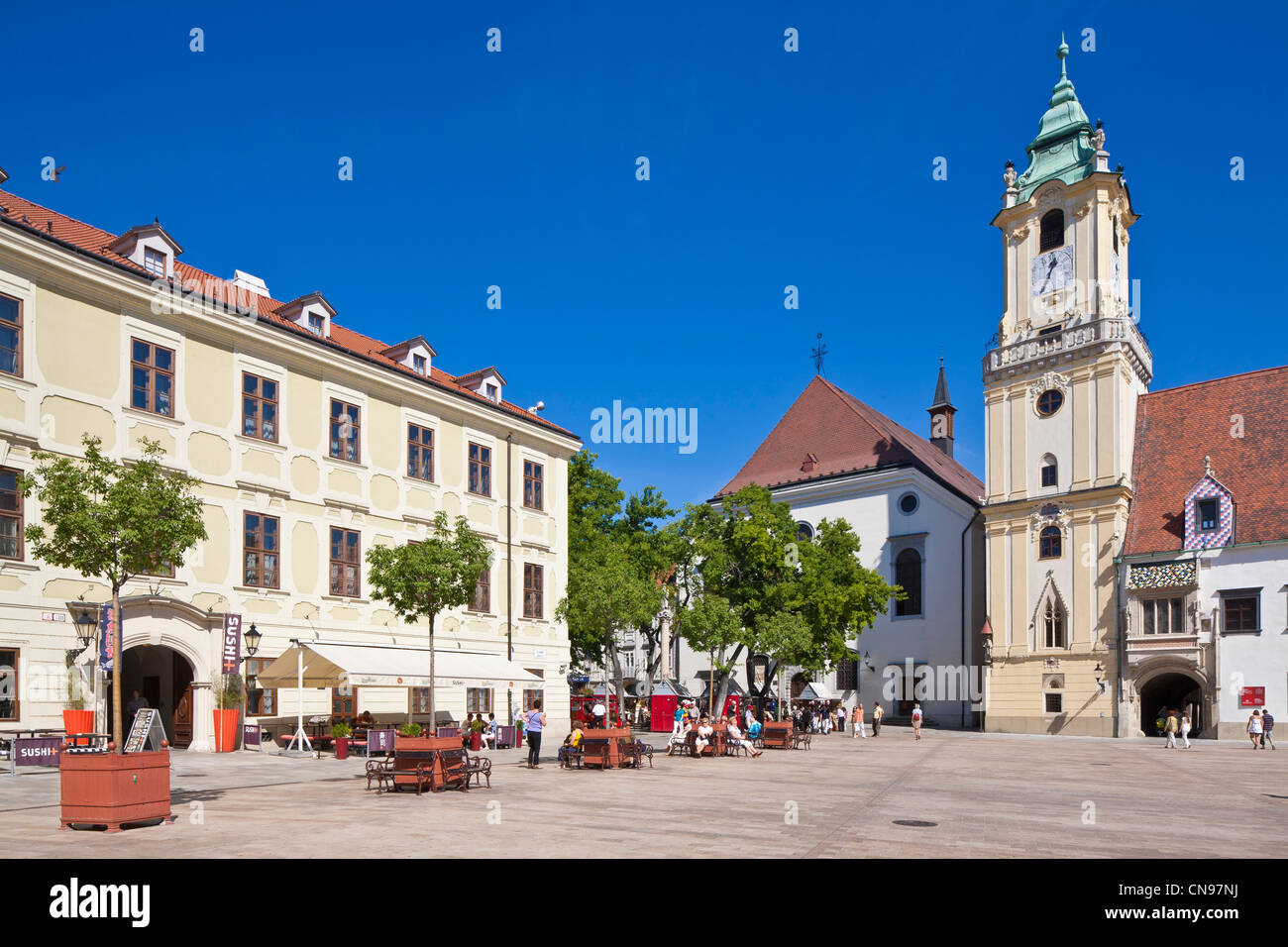 Slovakia, Bratislava, Historic center, main square with former city council on the right and its tower dating from - Stock Image