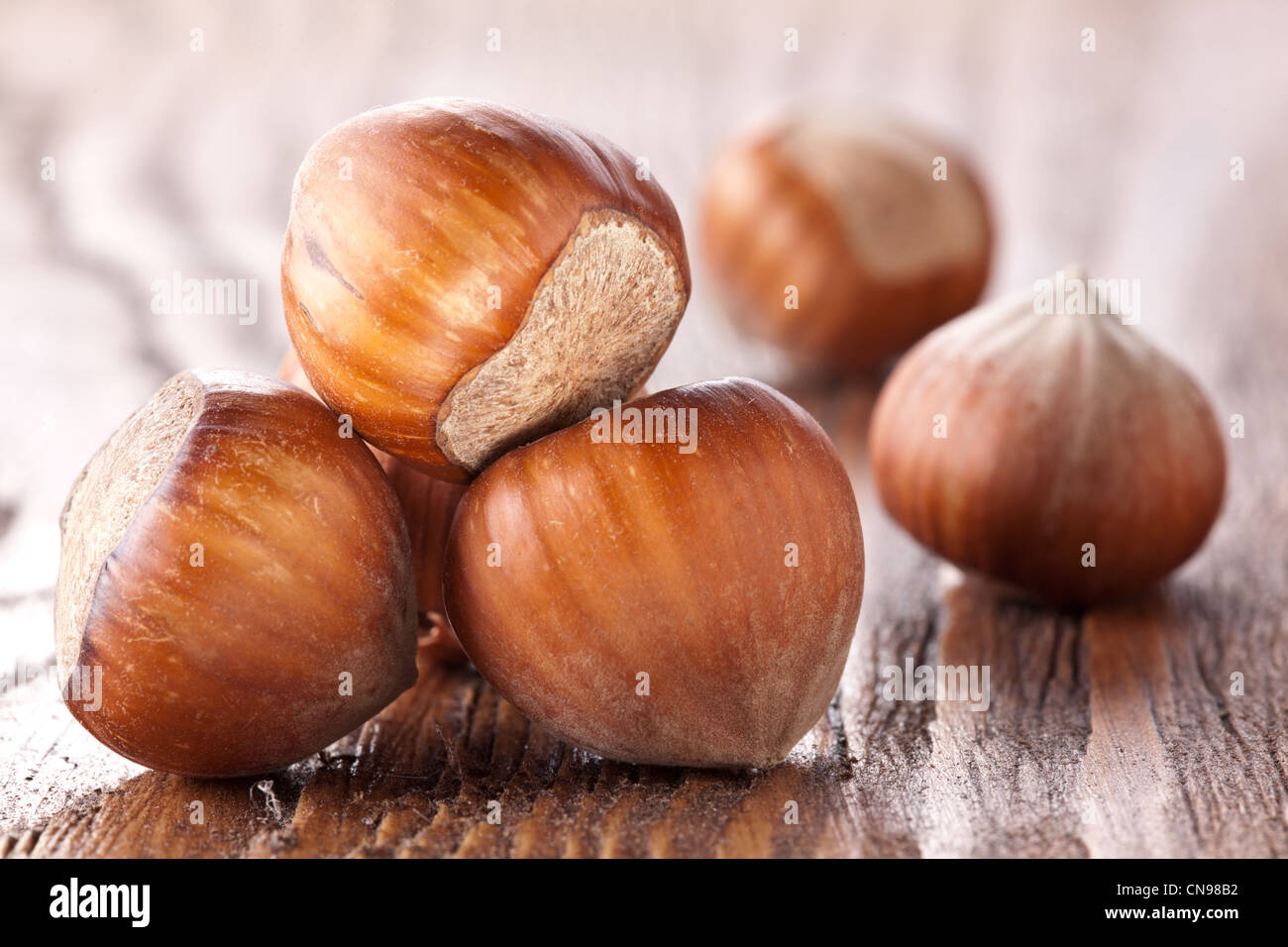 Filberts on a wooden table. Close-up shot. - Stock Image