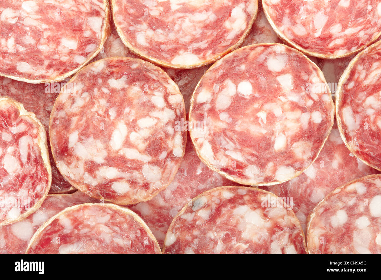 Salami slices texture background - Stock Image
