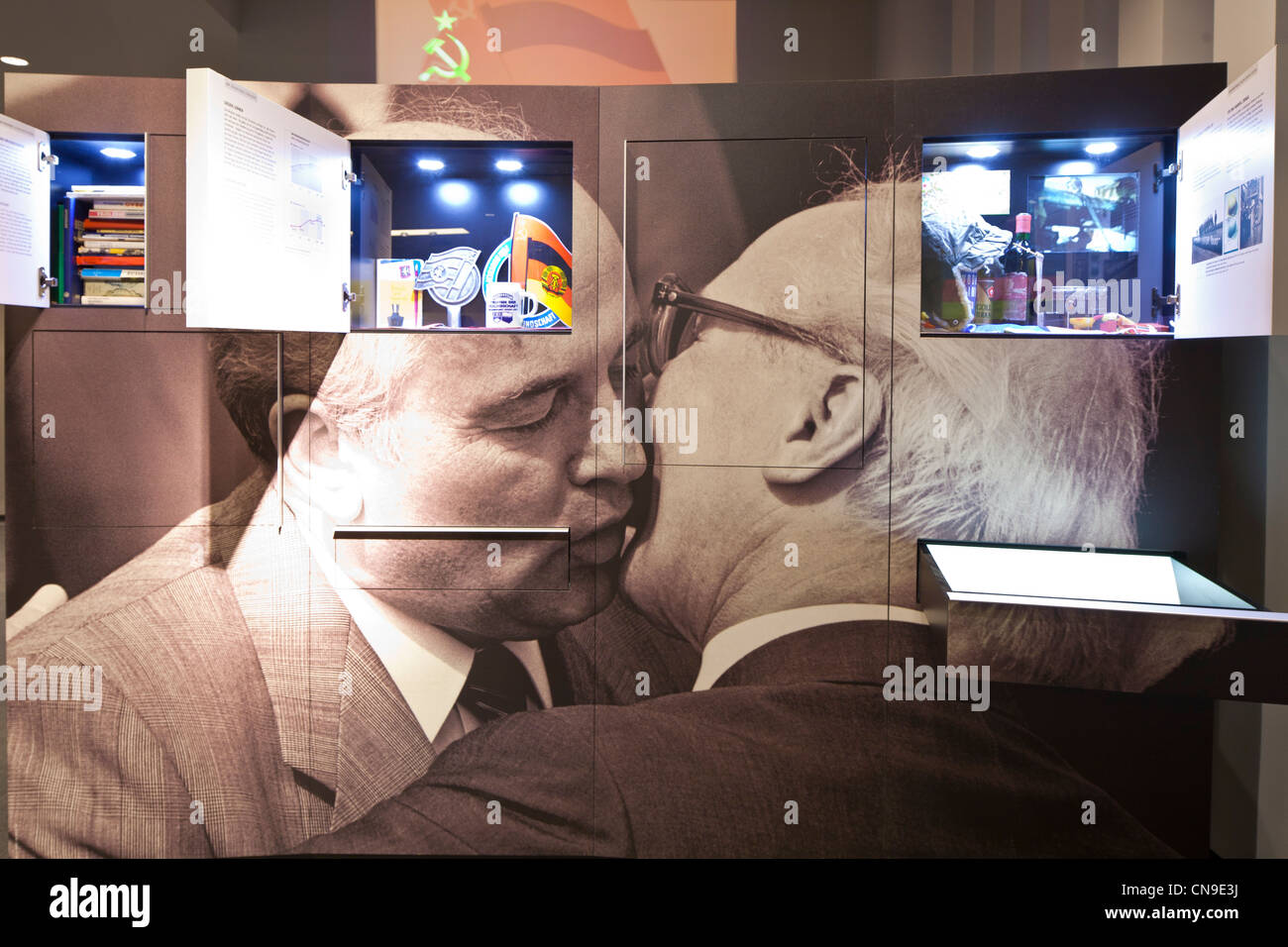 Germany, Berlin, DDR Museum, a museum opened in 2006 to recall the everyday life of former East Germany, kiss between - Stock Image