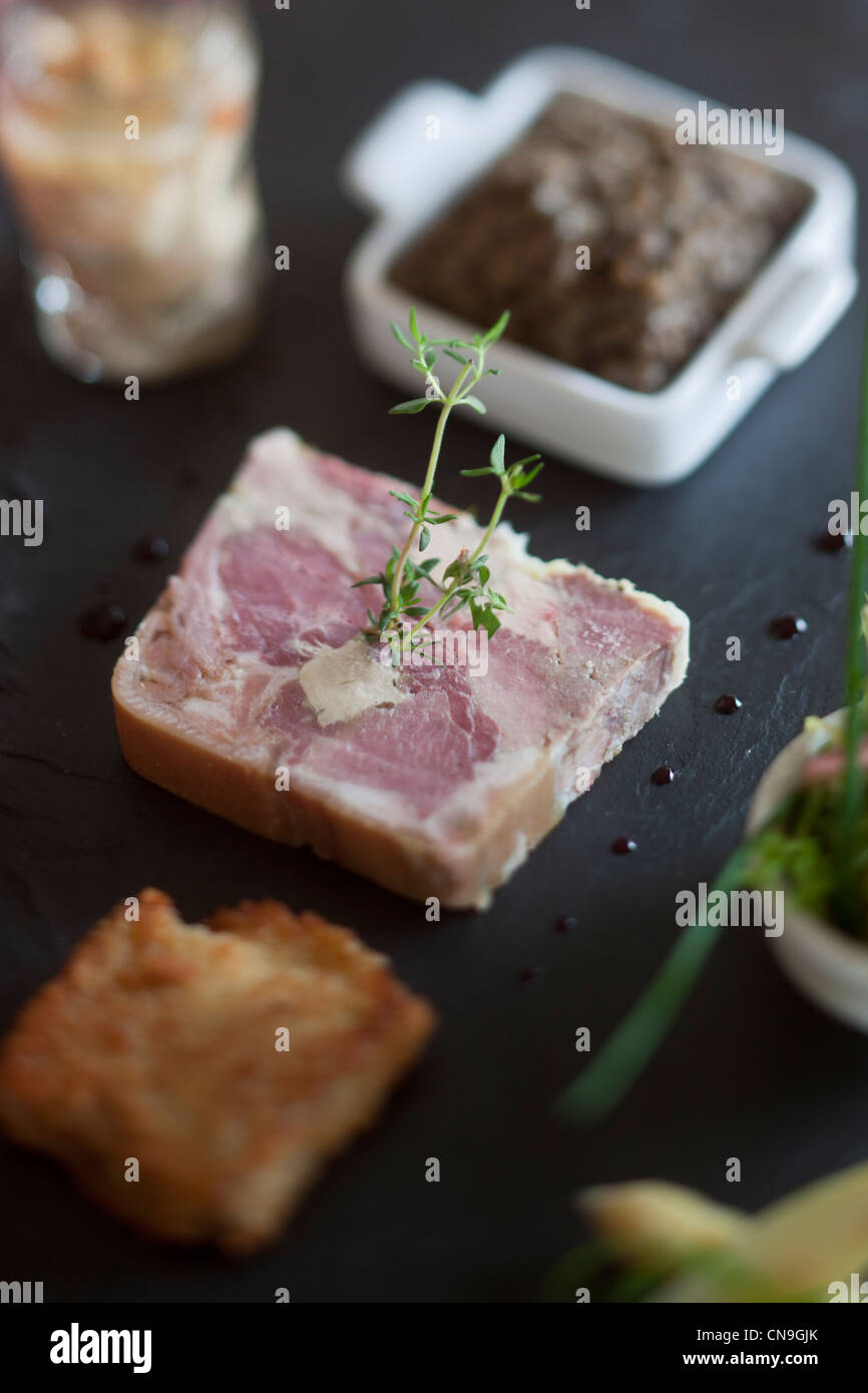 France, Cantal, St Clement, Pressed leg of pork and foie gras sauce invigorates, and caul of pork trotter and lentils, - Stock Image