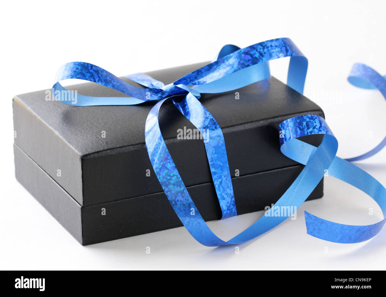 black gift box with a blue ribbon on a white background