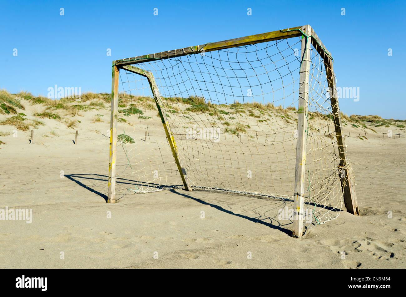 Football goal net on the beach of Ostia - Rome, Italy - Stock Image
