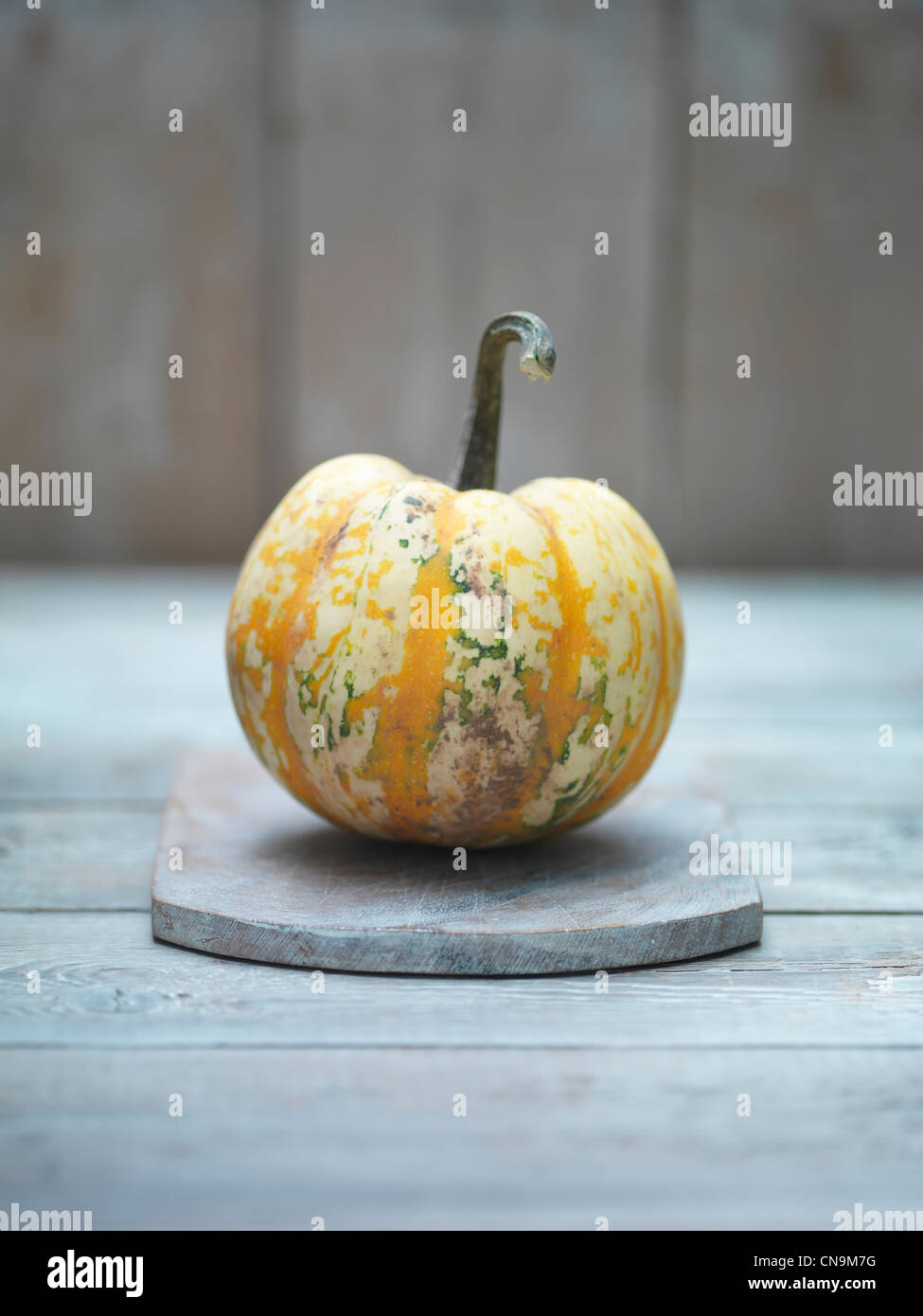 Yellow squash on wooden board - Stock Image