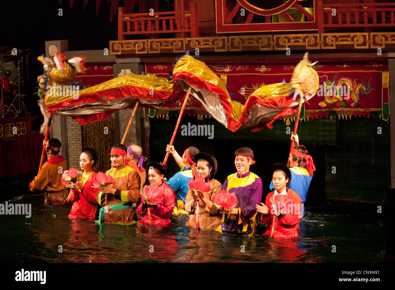 Puppeteers during the curtain call after the performance, Thang Long Water Puppet Theatre, Hanoi, Vietnam - Stock Image