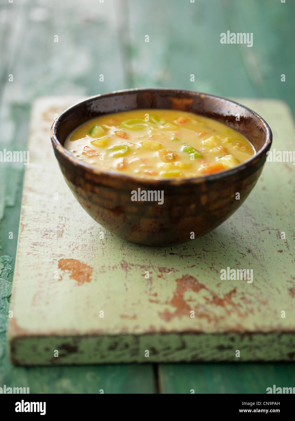Close up of bowl of vegetable soup - Stock Image