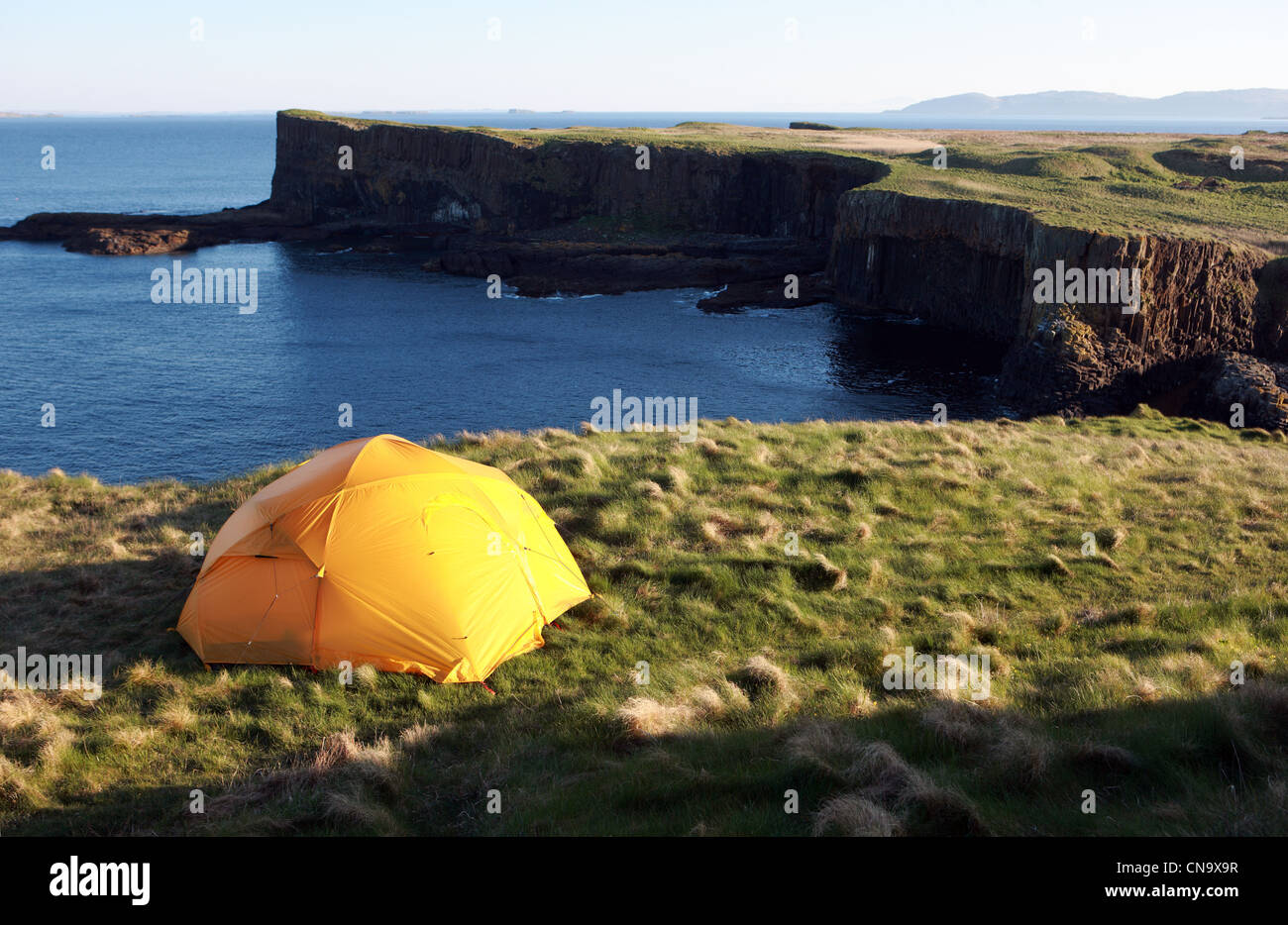 Yellow tent on the uninhabited island of Staffa in the Inner Hebrides of Scotland - Stock Image