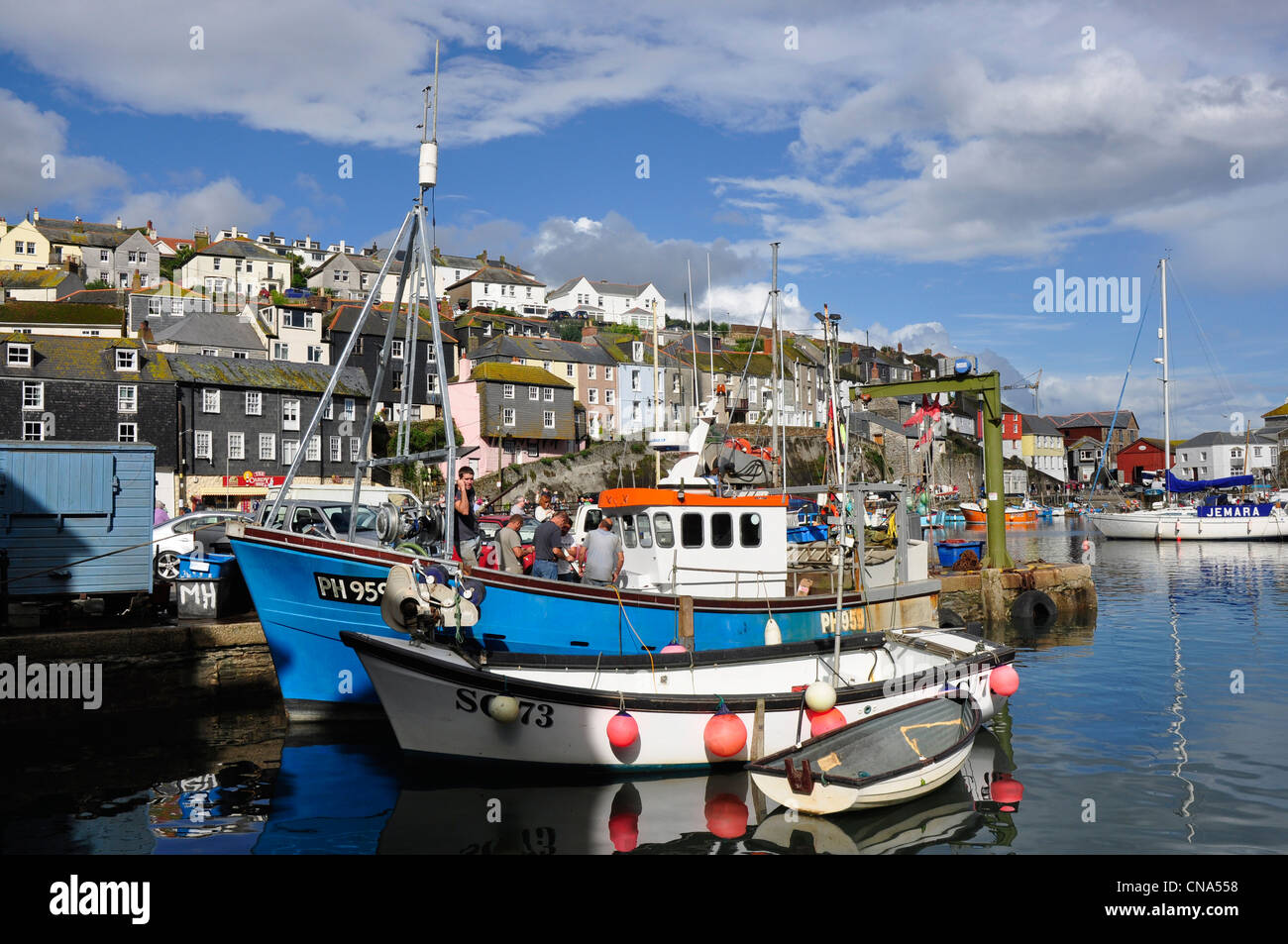Commercial fishing boats - Padstow harbour - summer sunlight - cloud flecked blue sky - Stock Image