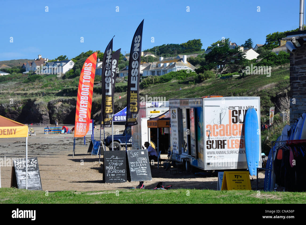 Cornwall - Hayle Bay beach - surf schools waiting for customers - bright summer sunlight - blue sky - Stock Image