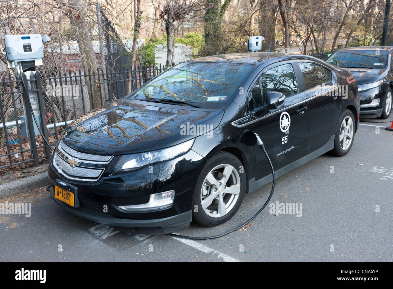 A Chevy Volt Hybrid Electric Car Used By The New York City Parks Department Receives Charge At Charging Station In Central Park