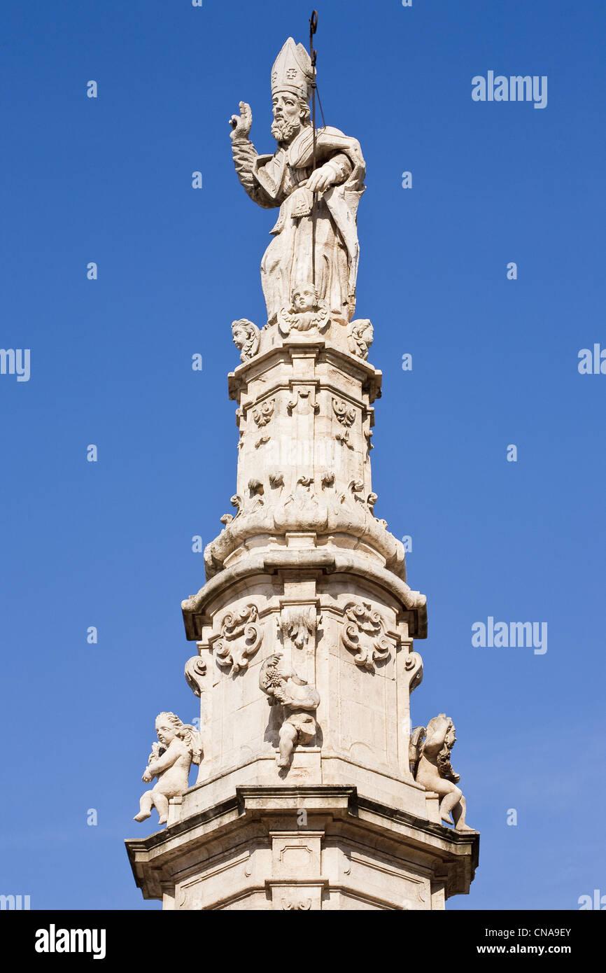 Italy, Puglia, Brindisi province, Ostuni, Liberta Square, baroque spire on Sant'Oronzo, in recognition of the - Stock Image