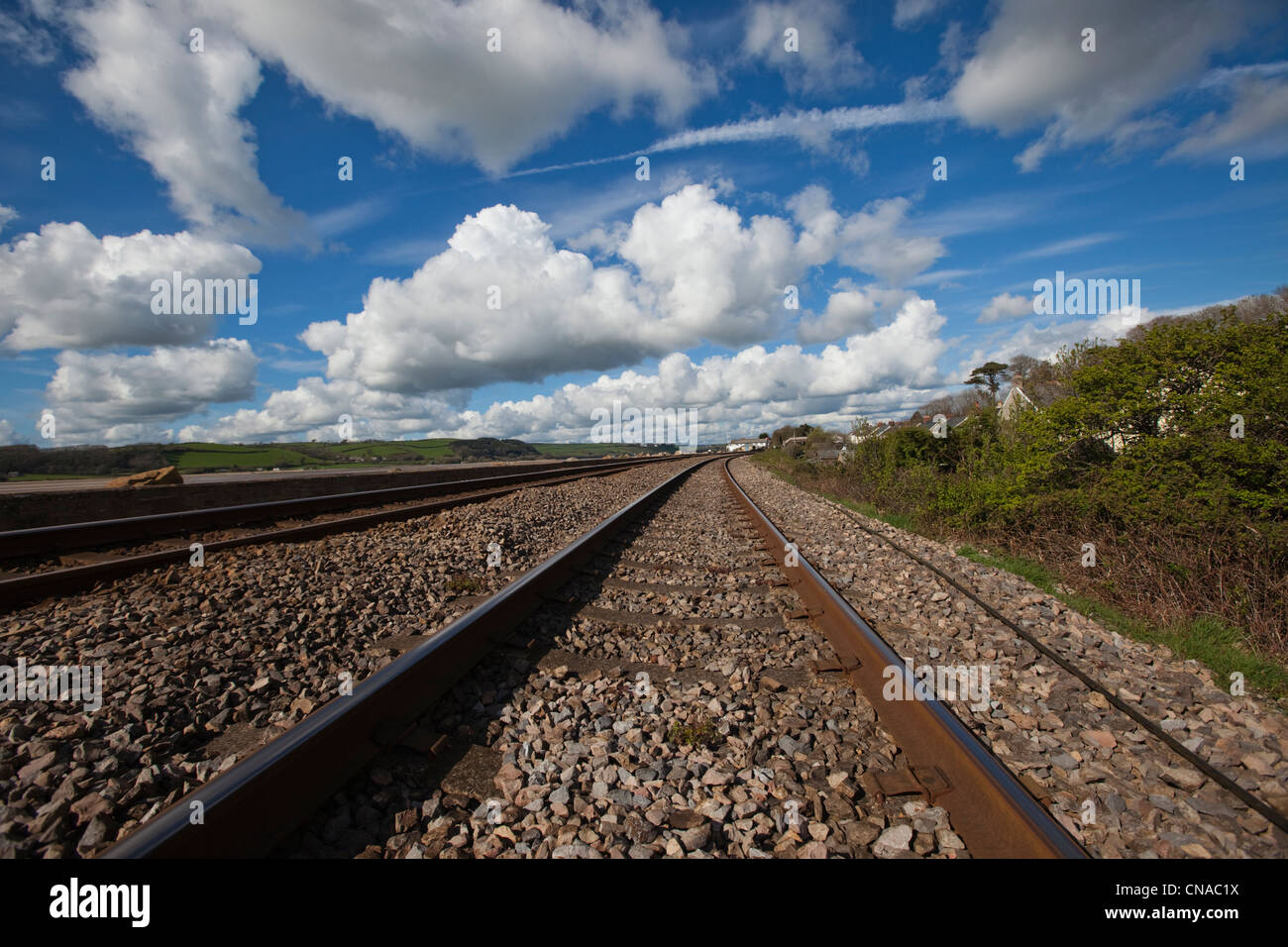 The West Wales train line passing along Ferryside seafront in Carmarthenshire. - Stock Image