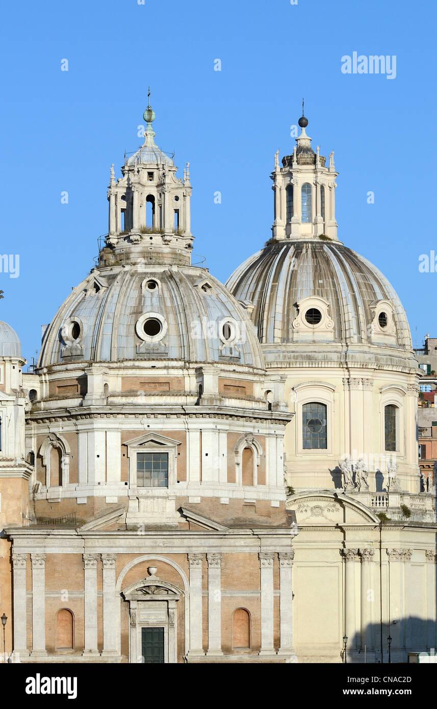 Italy, Lazio, Rome, the Trajan's column and the cupolas of Santissimo Nome di Maria al Foro Traiano and Santa - Stock Image