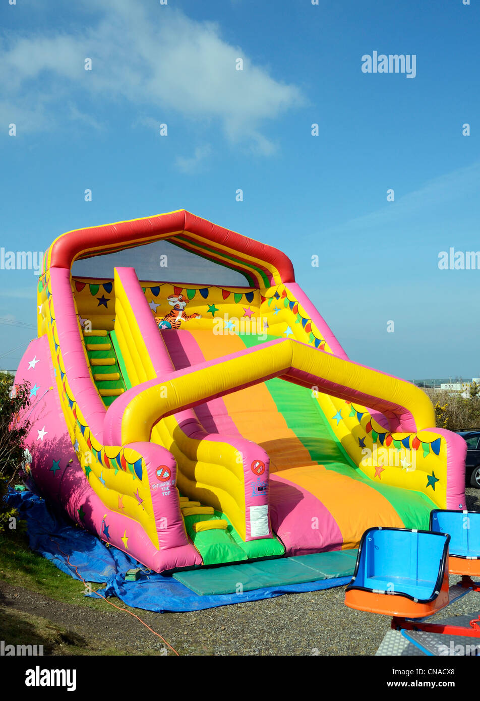 A childrens inflatable slide at a fun fair - Stock Image