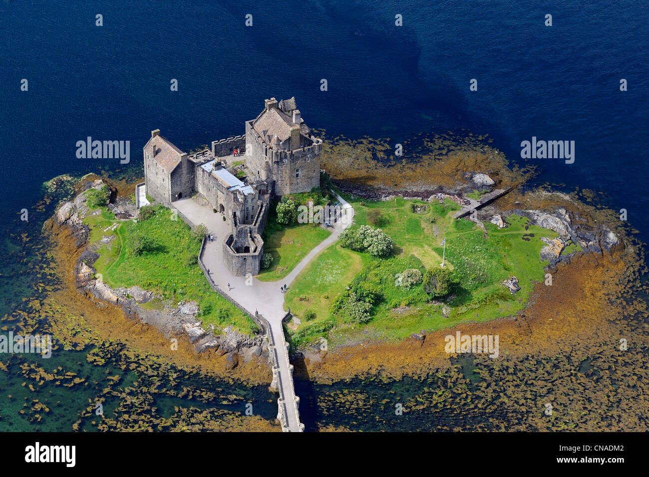 United Kingdom, Scotland, Highland, Dornie, Eilean Donan castle on the Loch Duich (aerial view) - Stock Image