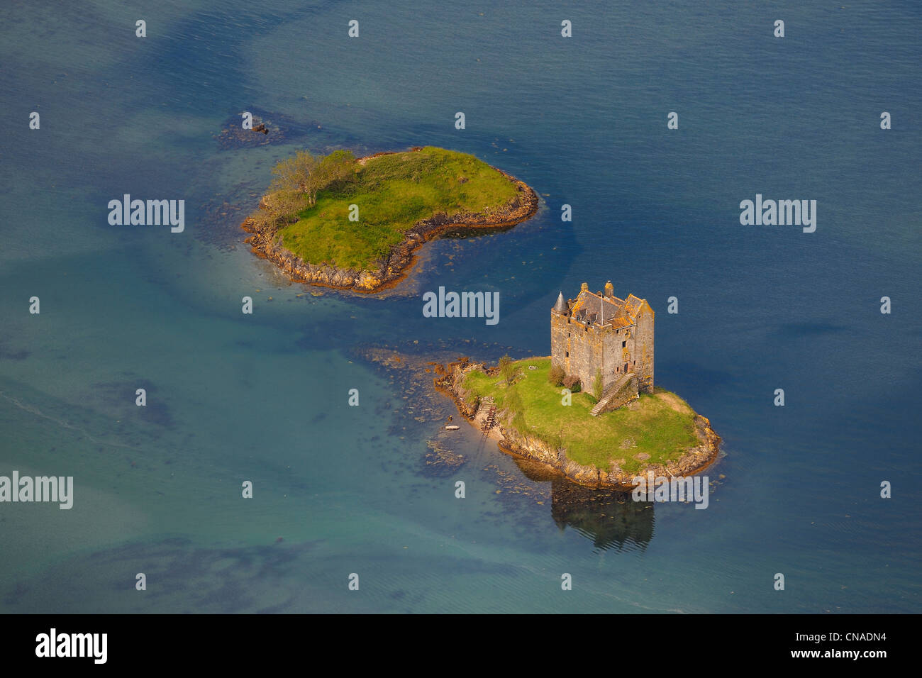 United Kingdom, Scotland, Highland, Port Appin, Castle Stalker is a four-storey tower house or keep picturesquely - Stock Image