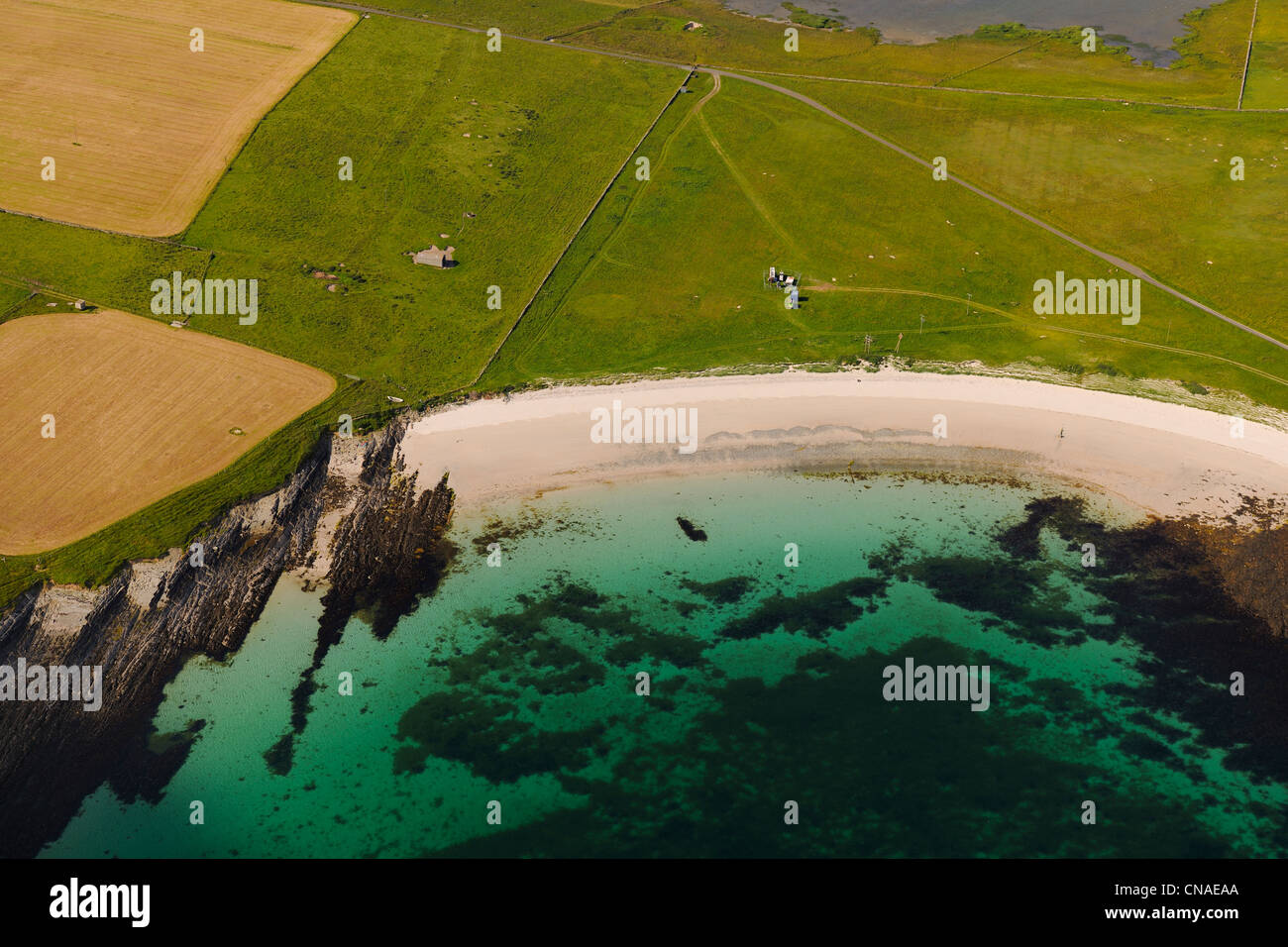 United Kingdom, Scotland, Orkney Islands, Papa Westray Island, beach and clear sea (aerial view) - Stock Image
