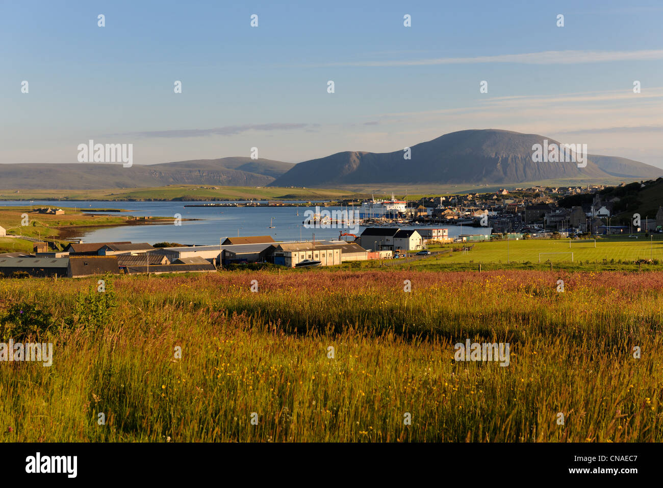 United Kingdom, Scotland, Orkney Islands, Mainland Island, Stromness Harbour in front of Ward Hill on Hoy that is - Stock Image