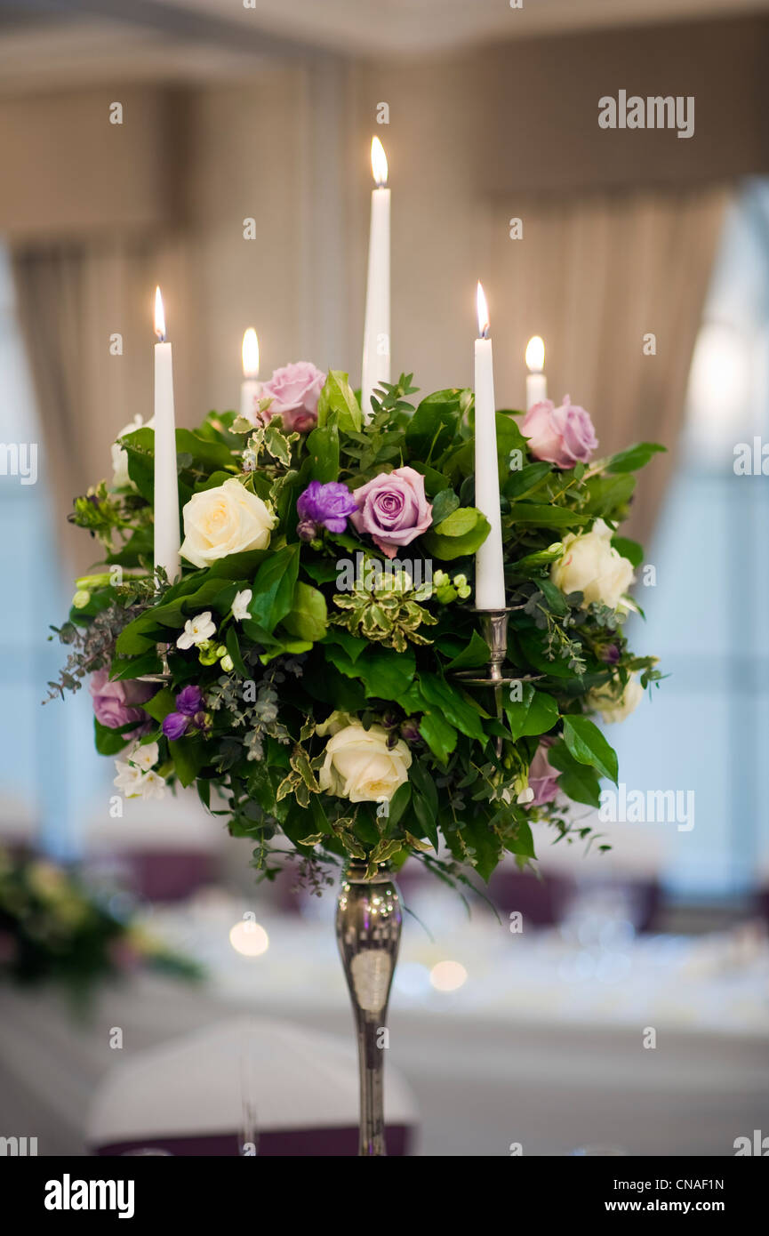 a table setting centrepiece (centerpiece) of flower bouquet at a ...