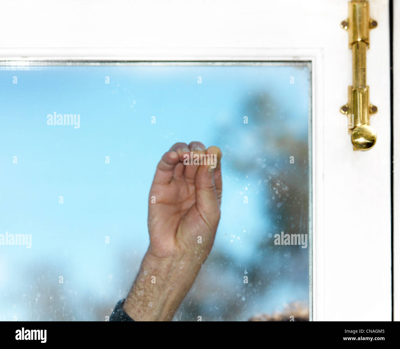 Fingers Tapping On Window - Stock Image