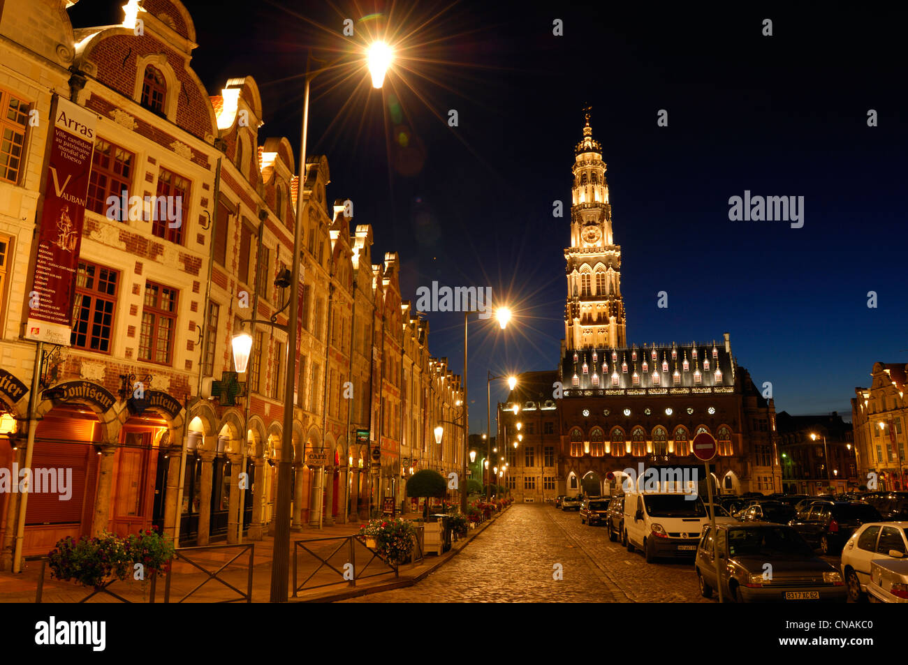 France, Pas de Calais, Arras, Place des Heros, Town Hall of Arras at night topped with its 77 meters belfry listed Stock Photo