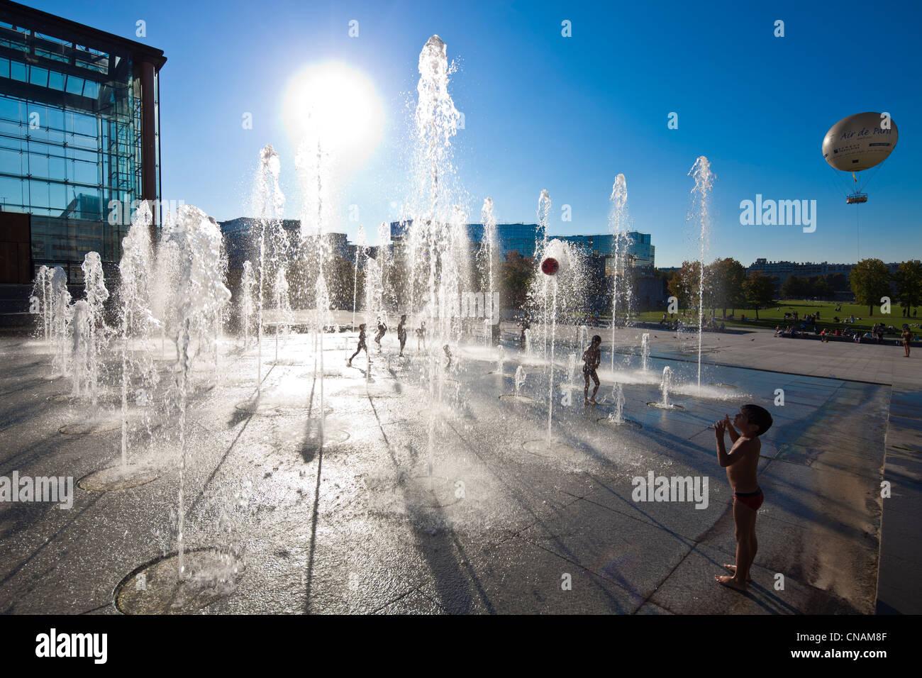 France, Paris, Andre Citroen park, 120 water jets are used as playground for children on hot summer days - Stock Image