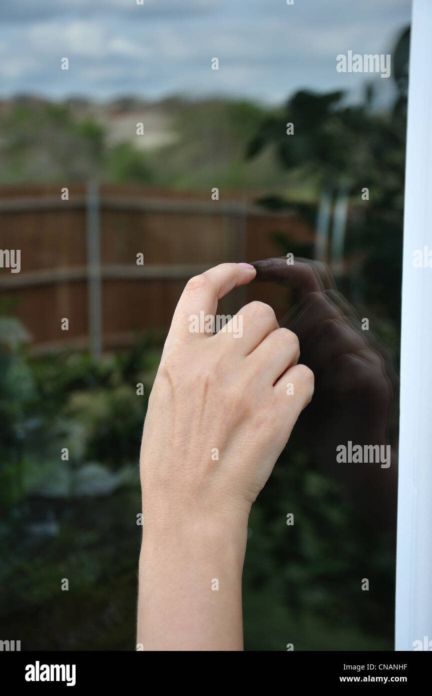 Hand tapping on the door - Stock Image