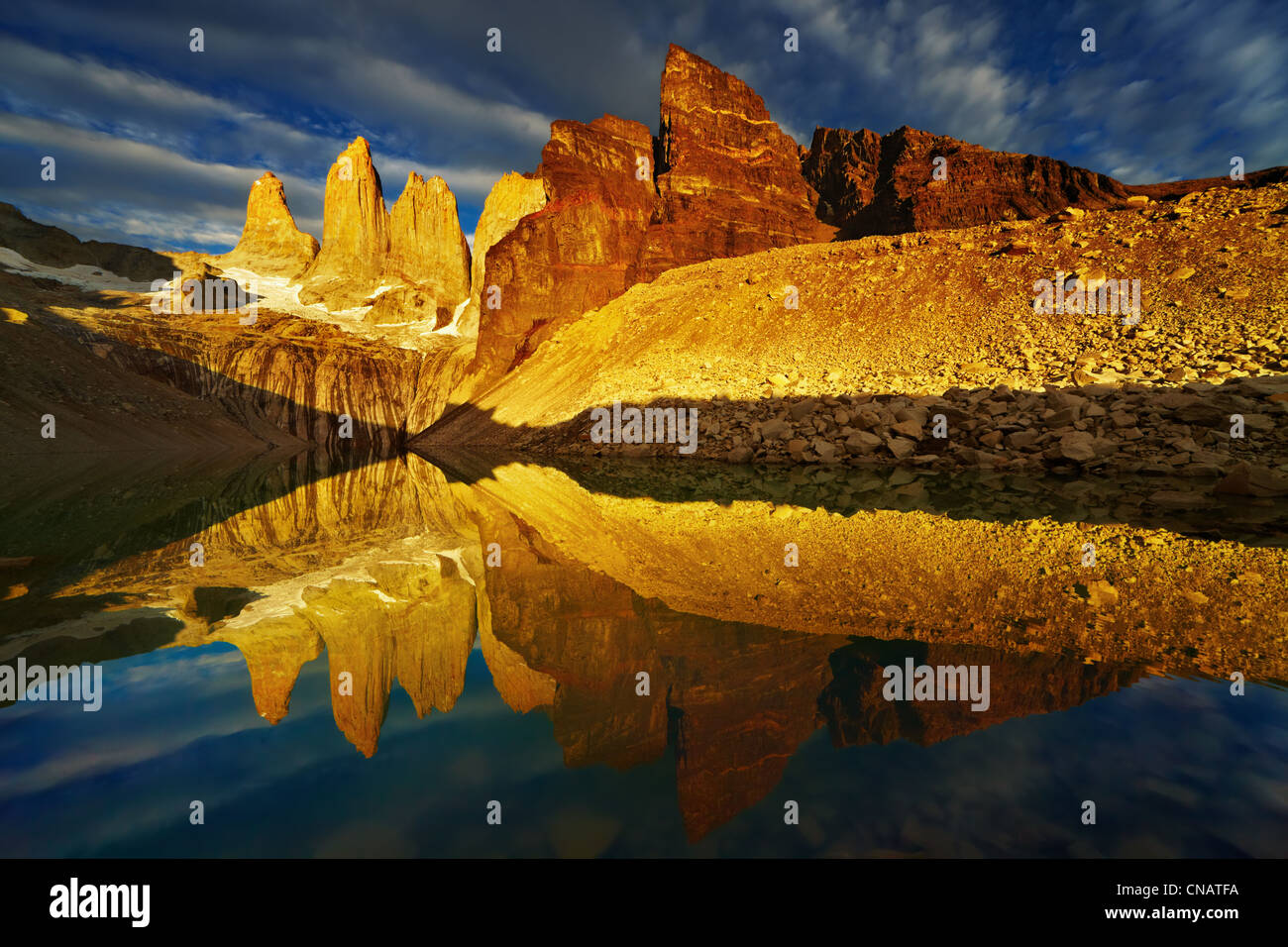 Towers with reflection at sunrise, Torres del Paine National Park, Patagonia, Chile - Stock Image