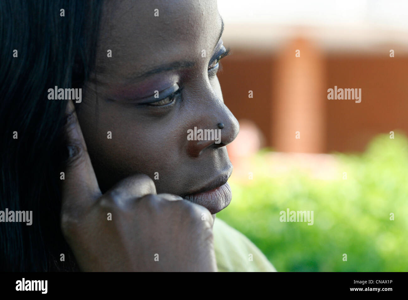 A young African woman looking thoughtful - Stock Image