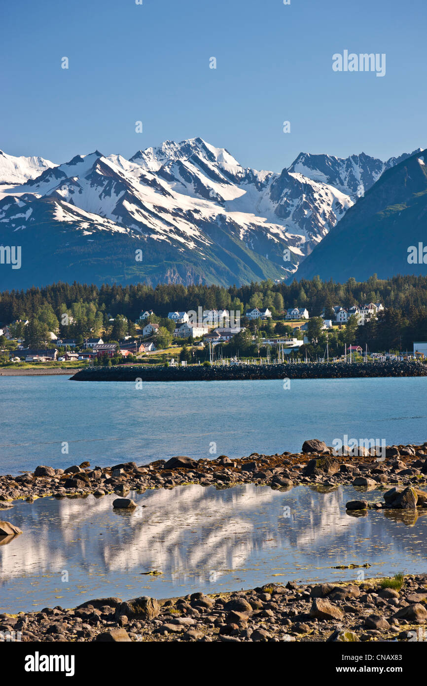 View from Portage Cove of Haines and Ft. Seward with a cruise ship docked in the harbor, Southeast Alaska, Summer - Stock Image
